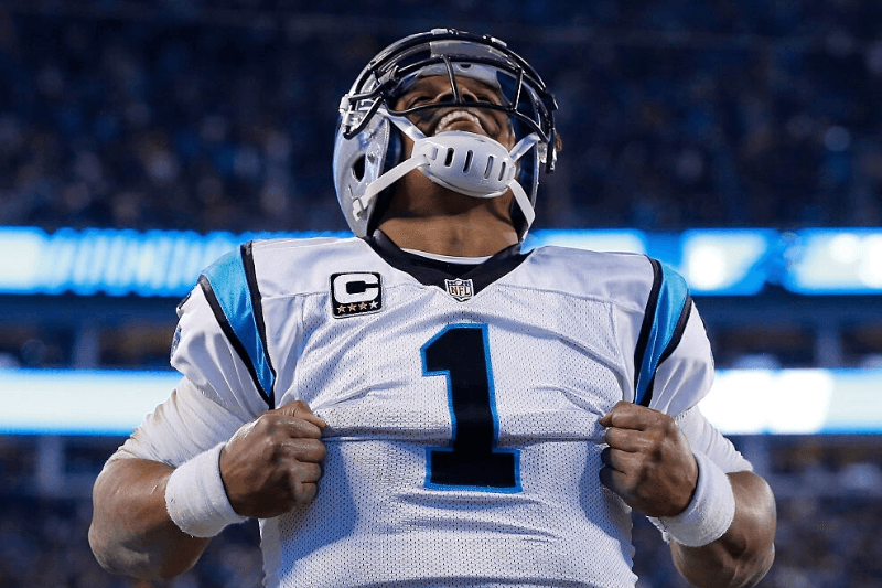 CHARLOTTE, NC - JANUARY 24: Cam Newton #1 of the Carolina Panthers celebrates after scoring a touchdown in the third quarter against the Arizona Cardinals during the NFC Championship Game at Bank of America Stadium on January 24, 2016 in Charlotte, North Carolina.