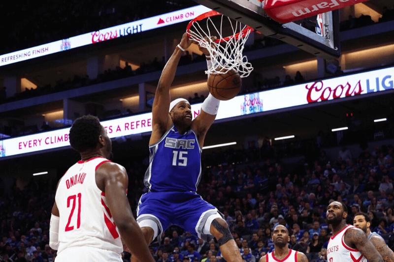Apr 11, 2018; Sacramento, CA, USA; Sacramento Kings guard Vince Carter (15) dunks the ball against the Houston Rockets during the fourth quarter at Golden 1 Center