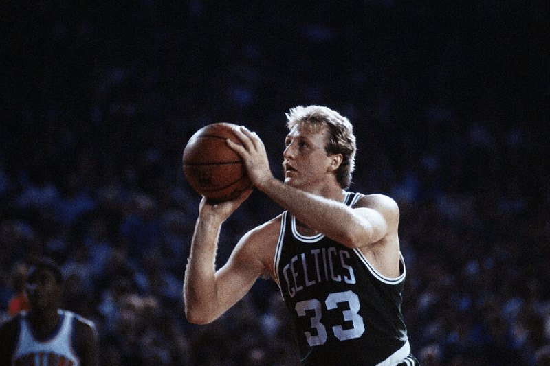 Boston Celtics forward Larry Bird shoots a free throw during a game against the Detroit Pistons at the Pontiac Silverdome in Pontiac, Michigan.