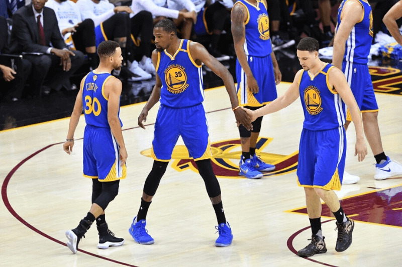 CLEVELAND, OH - JUNE 07: Stephen Curry #30, Kevin Durant #35 and Klay Thompson #11 of the Golden State Warriors react against the Cleveland Cavaliers during the first half of Game 3 of the 2017 NBA Finals at Quicken Loans Arena on June 7, 2017 in Cleveland, Ohio.