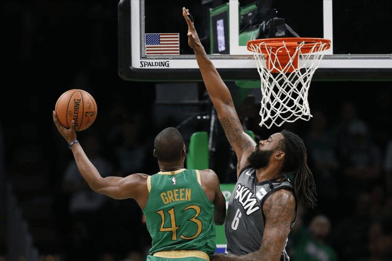 Mar 3, 2020; Boston, Massachusetts, USA; Boston Celtics point guard Javonte Green (43) drives against Brooklyn Nets center DeAndre Jordan (6) during overtime at TD Garden.