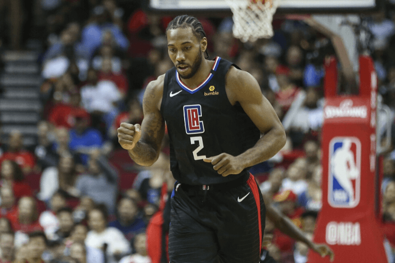 Mar 5, 2020; Houston, Texas, USA; Los Angeles Clippers forward Kawhi Leonard (2) reacts after scoring a basket during the second quarter against the Houston Rockets at Toyota Center.
