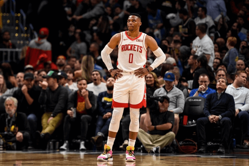 DENVER, CO - NOVEMBER 20: Russell Westbrook (0) of the Houston Rockets looks up at the clock late against the Denver Nuggets during the fourth quarter of Denver's 105-95 win on Wednesday, November 20, 2019.