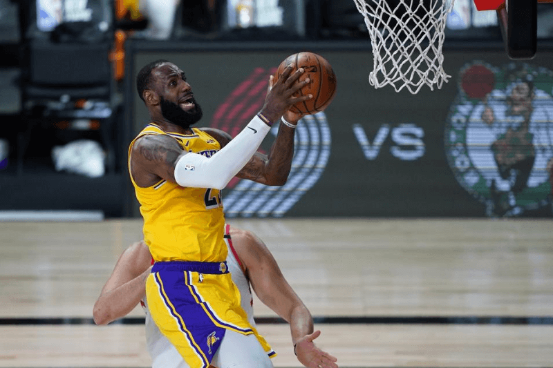 Aug 1, 2020; Lake Buena Vista, USA; Los Angeles Lakers forward LeBron James (23) shoots the ball against the Toronto Raptors during the first half.