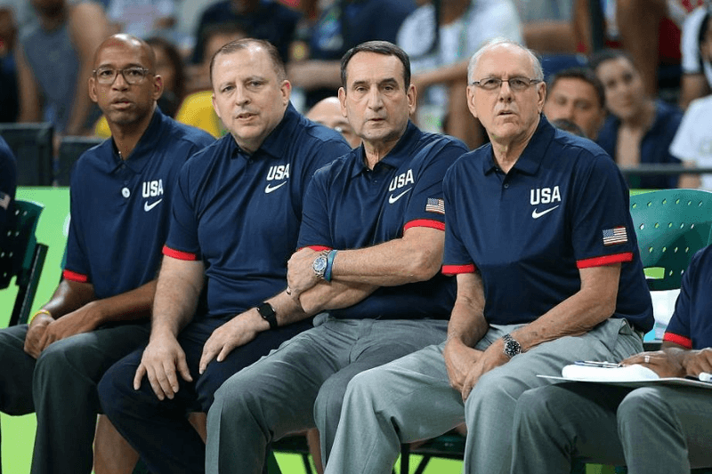 RIO DE JANEIRO, BRAZIL - AUGUST 6: Assistant coaches of USA Monty Williams, Tom Thibodeau, head coach of USA Mike Krzyzewski and assistant coach of USA Jim Boeheim look on during the group phase basketball match between USA and China on day 1 of the Rio 2016 Olympic Games at Carioca Arena 1 on August 6, 2016 in Rio de Janeiro, Brazil.