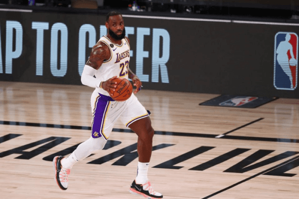 Aug 3, 2020; Lake Buena Vista, Florida, USA; Los Angeles Lakers forward LeBron James (23) brings the ball up court against the Utah Jazz during the first half of a NBA game at The Arena at the ESPN Wide World of Sports Complex.