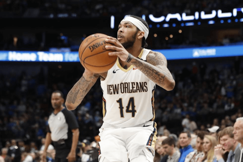Mar 4, 2020; Dallas, Texas, USA; New Orleans Pelicans forward Brandon Ingram (14) shoots during the second half against the Dallas Mavericks at American Airlines Center.