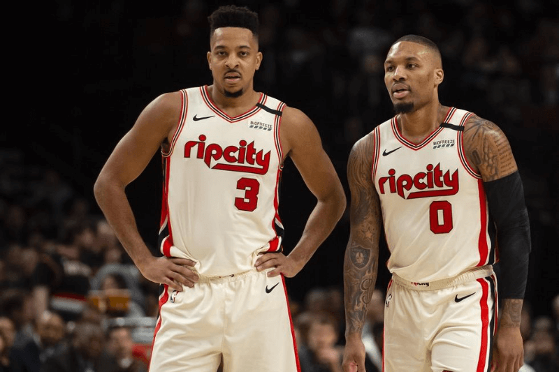 Mar 4, 2020; Portland, Oregon, USA; Portland Trail Blazers guard CJ McCollum (3) and guard Damian Lillard (0) during a break in action in the first half against the Washington Wizards at Moda Center.