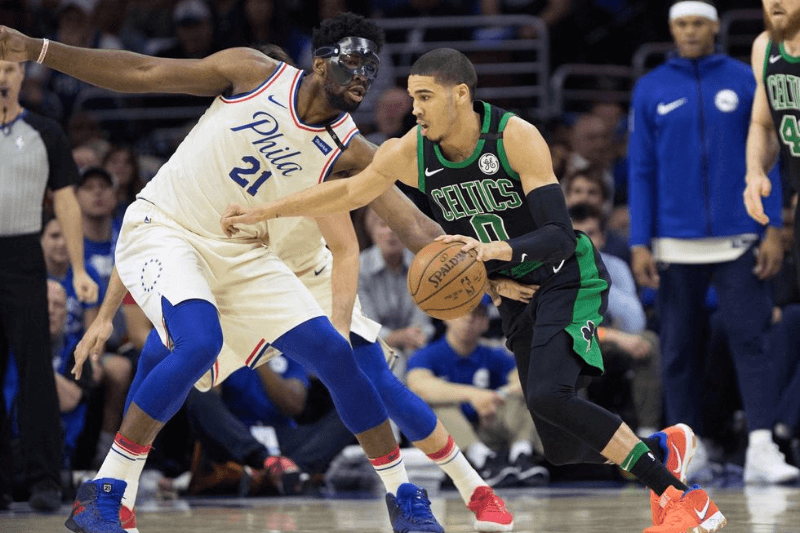 May 5, 2018; Philadelphia, PA, USA; Boston Celtics forward Jayson Tatum (0) dribbles against Philadelphia 76ers center Joel Embiid (21) during the first quarter in game three of the second round of the 2018 NBA Playoffs at Wells Fargo Center.