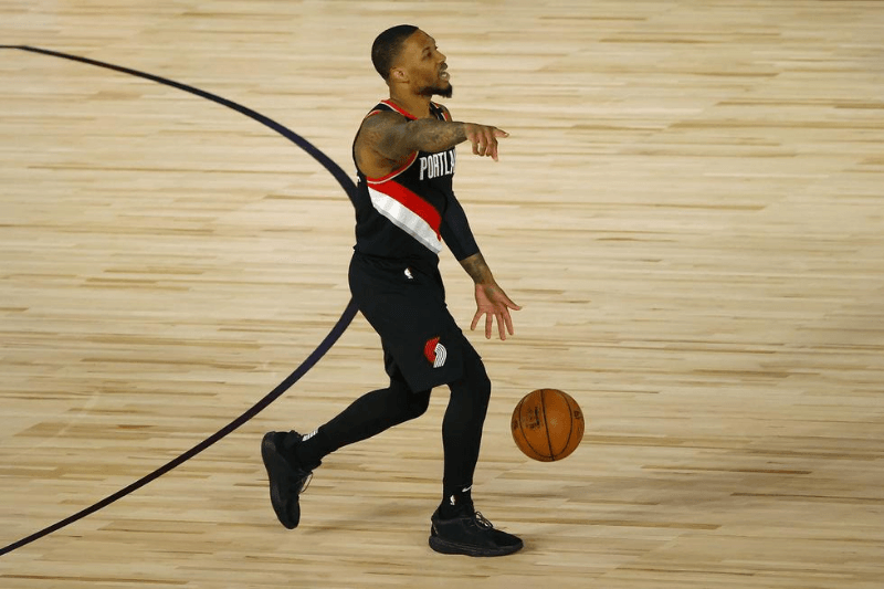 Aug 15, 2020; Lake Buena Vista, Florida, USA; Damian Lillard #0 of the Portland Trail Blazers sets up the play against the Memphis Grizzlies during the first quarter in the Western Conference play-in game one at The Field House.