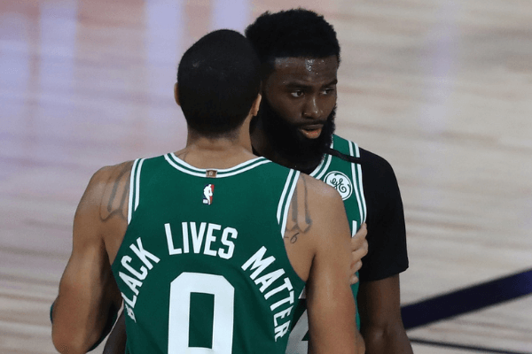 Sep 9, 2020; Lake Buena Vista, Florida, USA; Boston Celtics forward Jayson Tatum (0) and guard Jaylen Brown (7) react at the end of the first overtime period in game six against the Toronto Raptors in the second round of the 2020 NBA Playoffs at ESPN Wide World of Sports Complex. Mandatory Credit: Kim Klement-USA TODAY Sports