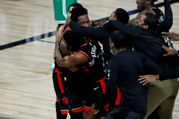 Sep 3, 2020; Lake Buena Vista, Florida, USA; Toronto Raptors forward OG Anunoby (3) is mobbed by teammates after making the game winning three point basket to defeat the against the Boston Celtics in game three of the second round of the 2020 NBA Playoffs at ESPN Wide World of Sports Complex. Mandatory Credit: Kim Klement-USA TODAY Sports