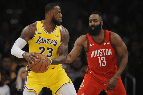February 21, 2019; Los Angeles, CA, USA; Los Angeles Lakers forward LeBron James (23) controls the ball against Houston Rockets guard James Harden (13) during the first half at Staples Center. Mandatory Credit: Gary A. Vasquez-USA TODAY Sports