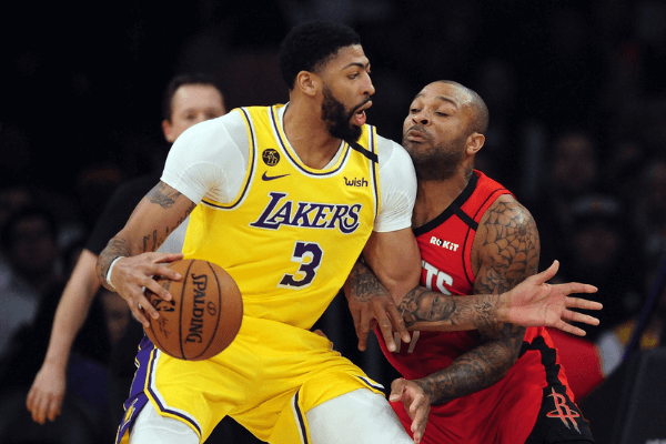 February 6, 2020; Los Angeles, California, USA; Los Angeles Lakers forward Anthony Davis (3) moves to the basket against Houston Rockets forward P.J. Tucker (17) during the first half at Staples Center. Mandatory Credit: Gary A. Vasquez-USA TODAY Sports