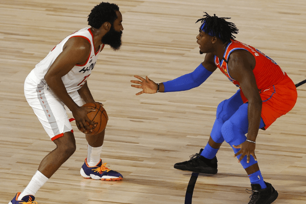 Aug 22, 2020; Lake Buena Vista, Florida, USA; James Harden #13 of the Houston Rockets drives against Luguentz Dort #5 of the Oklahoma City Thunder during the second quarter in game three of the first round of the 2020 NBA Playoffs at The Field House
