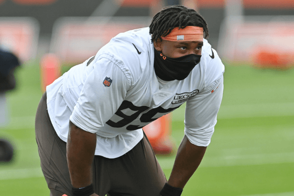 Aug 14, 2020; Berea, Ohio, USA; Cleveland Browns defensive end Myles Garrett (95) listens to a coach during training camp at the Cleveland Browns training facility.