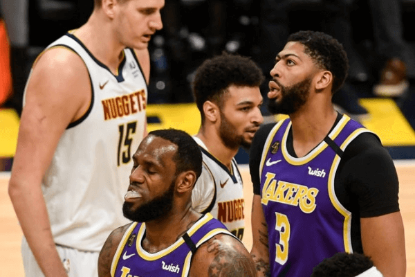 DENVER, CO - FEBRUARY 12: LeBron James (23) of the Los Angeles Lakers and Anthony Davis (3) react to the play of Nikola Jokic (15), Jamal Murray (27) and Torrey Craig (3) of the Denver Nuggets during the first quarter on Wednesday, February 12, 2020.
