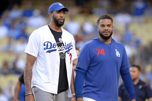 August 20, 2019; Los Angeles, CA, USA; Los Angeles Lakers player Anthony Davis with Los Angeles Dodgers relief pitcher Kenley Jansen (74) after throwing the ceremonial first pitch at Dodger Stadium. Mandatory Credit: Gary A. Vasquez-USA TODAY Sports