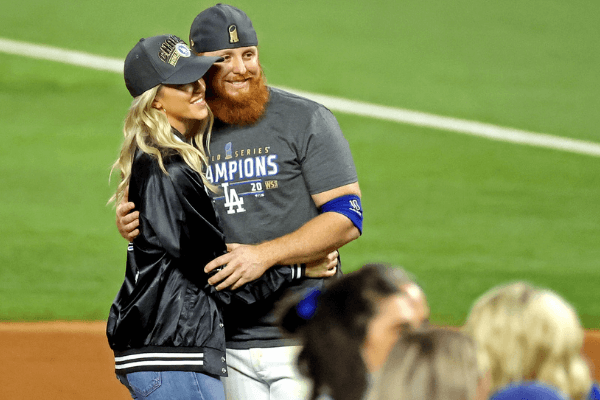 Oct 27, 2020; Arlington, Texas, USA; Los Angeles Dodgers third baseman Justin Turner (10) poses for a picture with his wife Kourtney Pogue after the Los Angeles Dodgers beat the Tampa Bay Rays to win the World Series in game six of the 2020 World Series at Globe Life Field. Mandatory Credit: Kevin Jairaj-USA TODAY Sports
