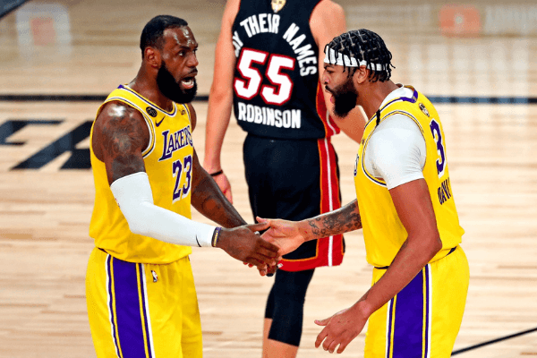 Sep 30, 2020; Orlando, Florida, USA; Los Angeles Lakers forward Anthony Davis (3) celebrates with forward LeBron James (23) after a play during the third quarter against the Miami Heat in game one of the 2020 NBA Finals at AdventHealth Arena.