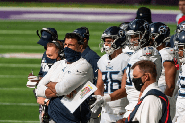 MINNEAPOLIS, MN - SEPTEMBER 27: Tennessee Titans head coach Mike Vrabel stands on the sidelines during the first quarter of the game against the Minnesota Vikings at U.S. Bank Stadium on September 27, 2020 in Minneapolis, Minnesota.