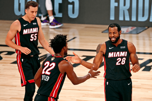 Oct 6, 2020; Miami, Florida, USA; Miami Heat forward Jimmy Butler (22) celebrates with guard Andre Iguodala (28) during the third quarter in game 4 of the 2020 NBA Finals at AdventHealth Arena.