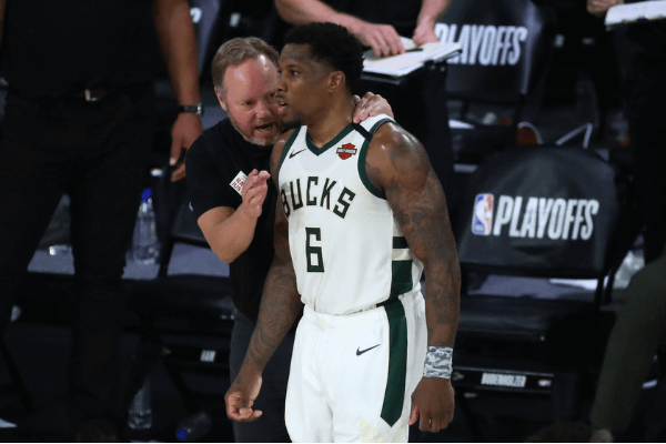 Sep 8, 2020; Lake Buena Vista, Florida, USA; Milwaukee Bucks head coach Mike Budenholzer talks with guard Eric Bledsoe (6) during the second half of game five in the second round of the 2020 NBA Playoffs against the Miami Heat at ESPN Wide World of Sports Complex.