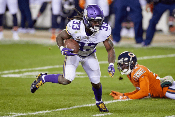 Minnesota Vikings running back Dalvin Cook (33) runs with the football in action during a NFL game between the Minnesota Vikings and the Chicago Bears on November 16, 2020 at Soldier Field, in Chicago, IL.