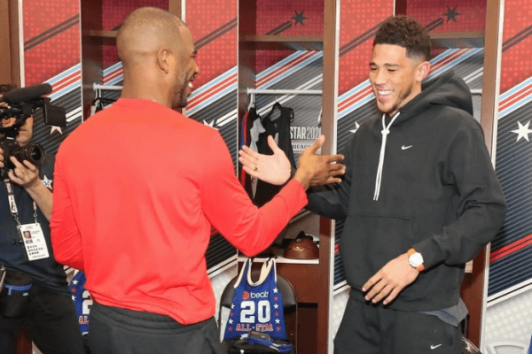 Chris Paul #3 of the Oklahoma City Thunder and Devin Booker #1 of the Phoenix Suns shake hands during Practice and Media Availability presented by AT&T as part of 2020 NBA All-Star Weekend on February 15, 2020 at Wintrust Arena in Chicago, Illinois.