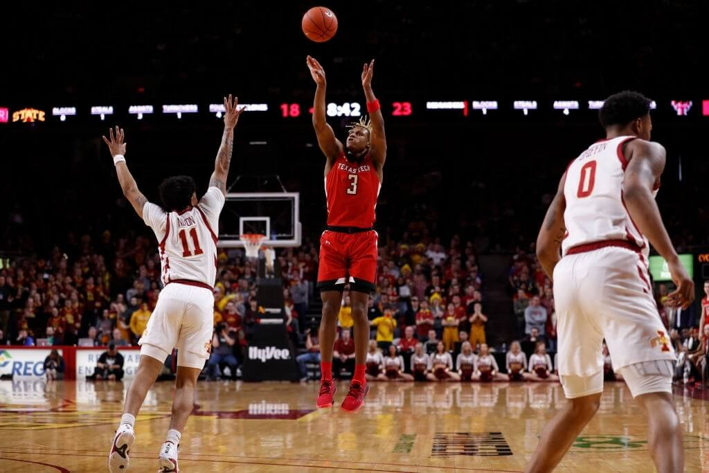 Jahmi'us Ramsey #3 of the Texas Tech Red Raiders takes a three point shot as Prentiss Nixon #11 of the Iowa State Cyclones blocks in the first half of the play at Hilton Coliseum on February 22, 2020 in Ames, Iowa.