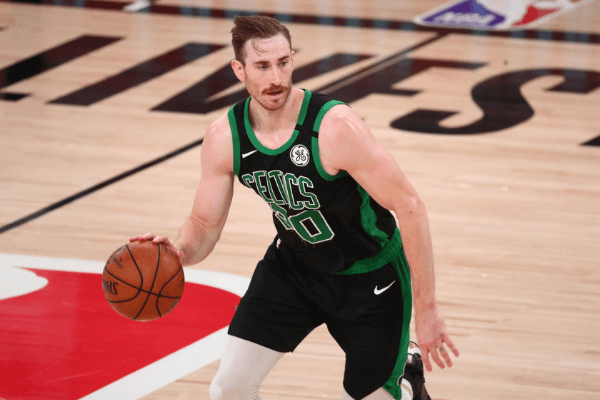 Sep 25, 2020; Lake Buena Vista, Florida, USA; Boston Celtics forward Gordon Hayward (20) controls the ball against the Miami Heat during the second half in game five of the Eastern Conference Finals of the 2020 NBA Playoffs at AdventHealth Arena.