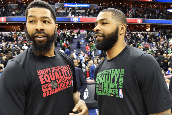 Feb 8, 2018; Washington, DC, USA; Washington Wizards forward Markieff Morris (left) talks with twin brother Boston Celtics forward Marcus Morris (right) after the game at Capital One Arena.