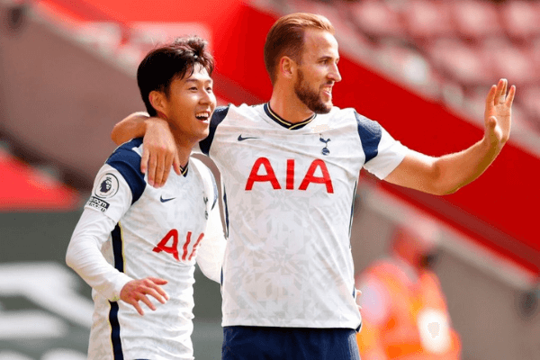 Tottenham Hotspur's South Korean striker Son Heung-Min celebrates with Tottenham Hotspur's English striker Harry Kane (R) after scoring his and their third goal during the English Premier League football match between Southampton and Tottenham Hotspur at St Mary's Stadium in Southampton, southern England on September 20, 2020.