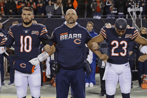 Head coach Matt Nagy of the Chicago Bears stands during the National Anthem with Mitchell Trubisky #10, and Kyle Fuller #23 before a game against the Kansas City Chiefs at Soldier Field on December 22, 2019 in Chicago, Illinois. The Chiefs defeated the Bears 26-3.