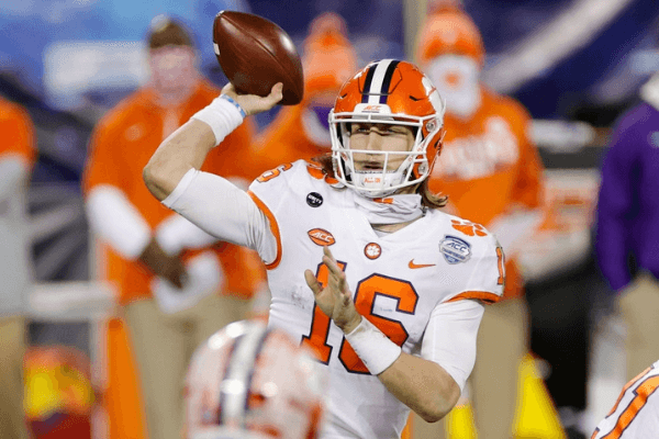 Quarterback Trevor Lawrence #16 of the Clemson Tigers throws a pass in the fourth quarter against the Notre Dame Fighting Irish during the ACC Championship game at Bank of America Stadium on December 19, 2020 in Charlotte, North Carolina.