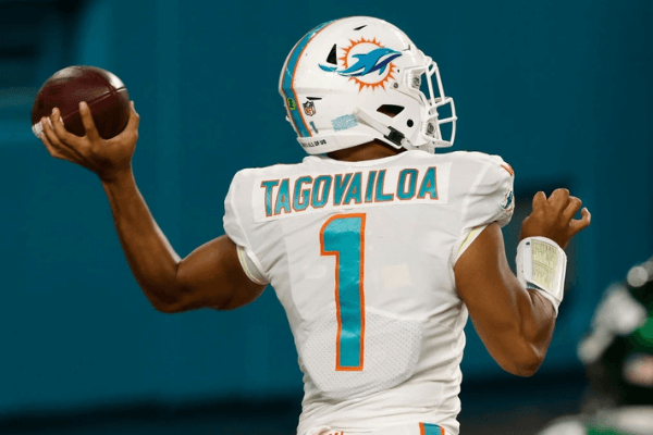 Quarterback Tua Tagovailoa #1 of the Miami Dolphins makes his first completed pass during the second half of their game against the New York Jets at Hard Rock Stadium on October 18, 2020 in Miami Gardens, Florida.