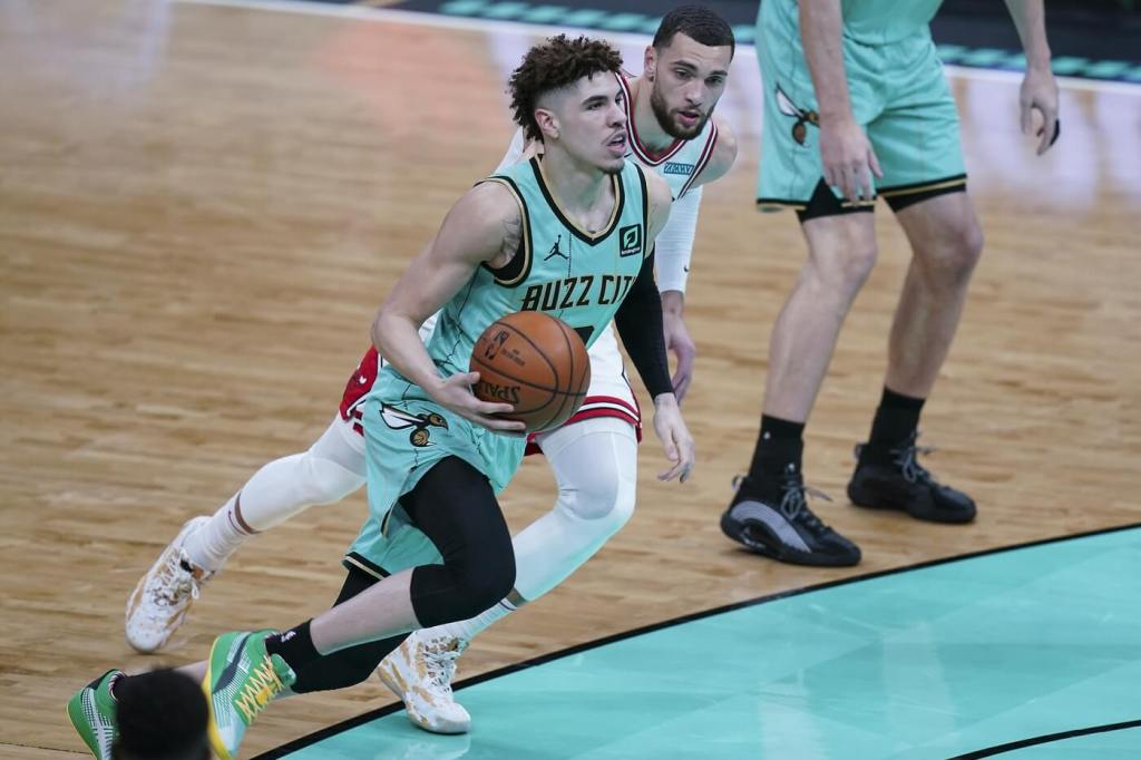 Charlotte Hornets guard LaMelo Ball (2) drives to the basket past Chicago Bulls guard Zach LaVine (8) during the first quarter at Spectrum Center.