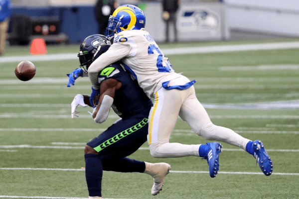 Jalen Ramsey #20 of the Los Angeles Rams breaks up a pass intended for DK Metcalf #14 of the Seattle Seahawks during the second quarter at Lumen Field on December 27, 2020 in Seattle, Washington.