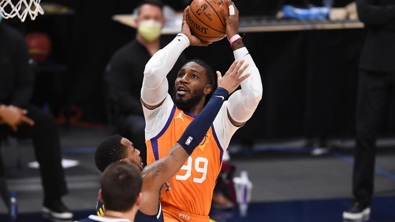 Jan 1, 2021; Denver, Colorado, USA; Phoenix Suns forward Jae Crowder (99) shoots the ball over Denver Nuggets guard Monte Morris (11) in the second quarter at Ball Arena. Mandatory Credit: Ron Chenoy-USA TODAY Sports