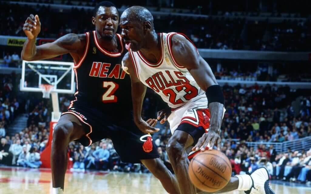 Unknown Date; Chicago, IL, USA; FILE PHOTO; Chicago Bulls guard (23) Michael Jordan drives against Miami Heat guard (2) Keith Askins at the United Center. Mandatory Credit: Photo By Brian Spurlock-USA TODAY Sports (c) Copyright 1997 Brian Spurlock