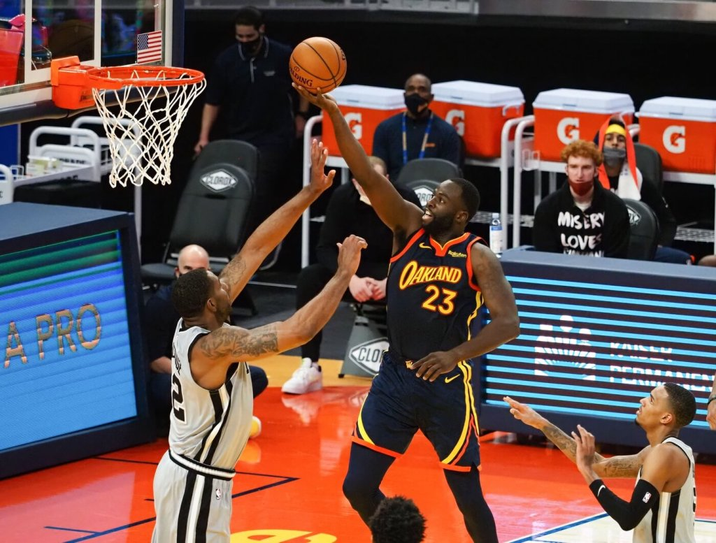 Jan 20, 2021; San Francisco, California, USA; Golden State Warriors forward Draymond Green (23) shoots the ball above San Antonio Spurs forward LaMarcus Aldrige (12) during the third quarter at Chase Center. Mandatory Credit: Kelley L Cox-USA TODAY Sports