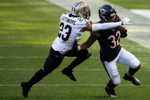 David Montgomery #32 of the Chicago Bears runs the ball against Marshon Lattimore #23 of the New Orleans Saints in the first quarter at Soldier Field on November 01, 2020 in Chicago, Illinois.