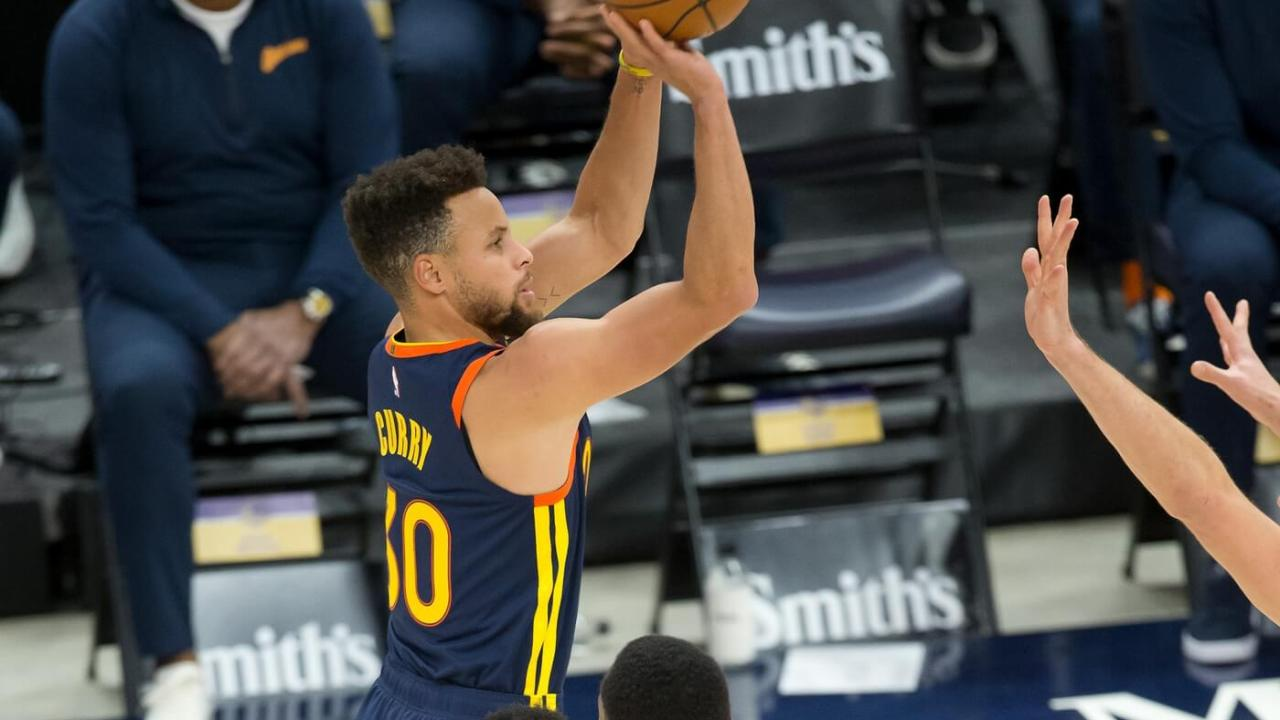 Jan 23, 2021; Salt Lake City, Utah, USA; Golden State Warriors guard Stephen Curry (30) shoots the ball during the first quarter against the Utah Jazz at Vivint Smart Home Arena. Mandatory Credit: Russell Isabella-USA TODAY Sports