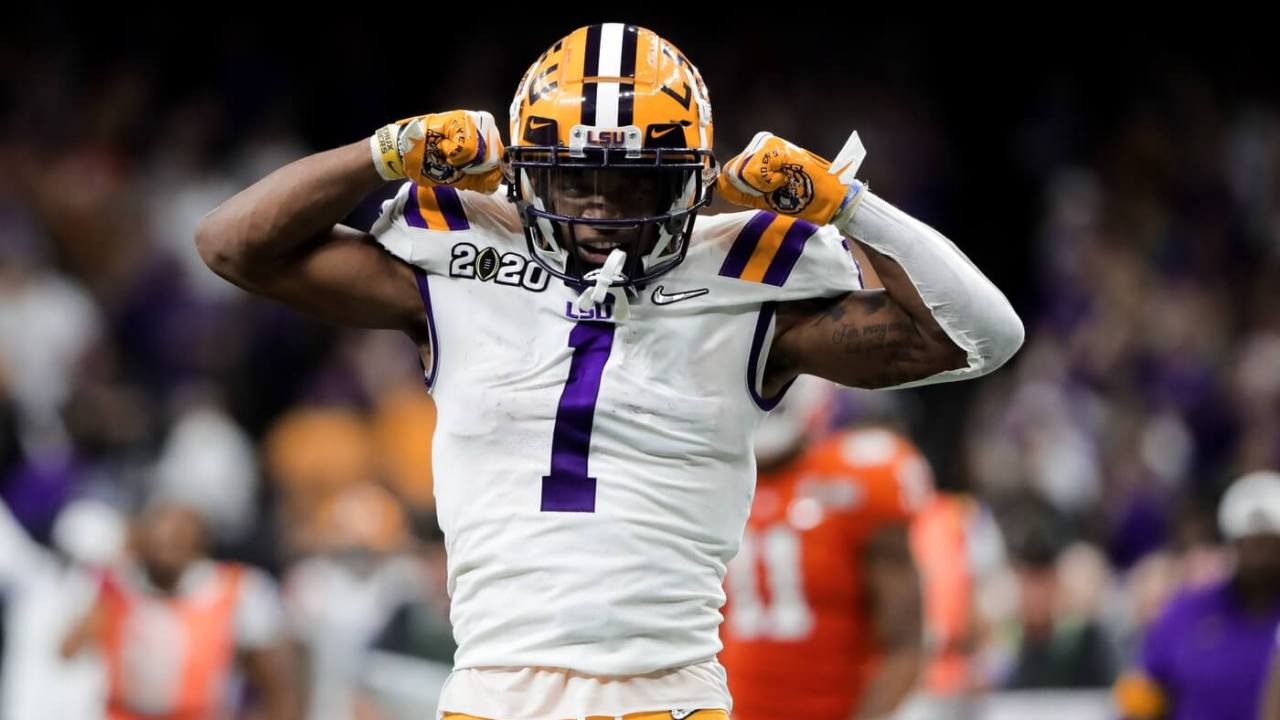 LSU Tigers wide receiver Ja'Marr Chase (1) reacts after a first down catch and run against the Clemson Tigers in the College Football Playoff national championship game at Mercedes-Benz Superdome.
