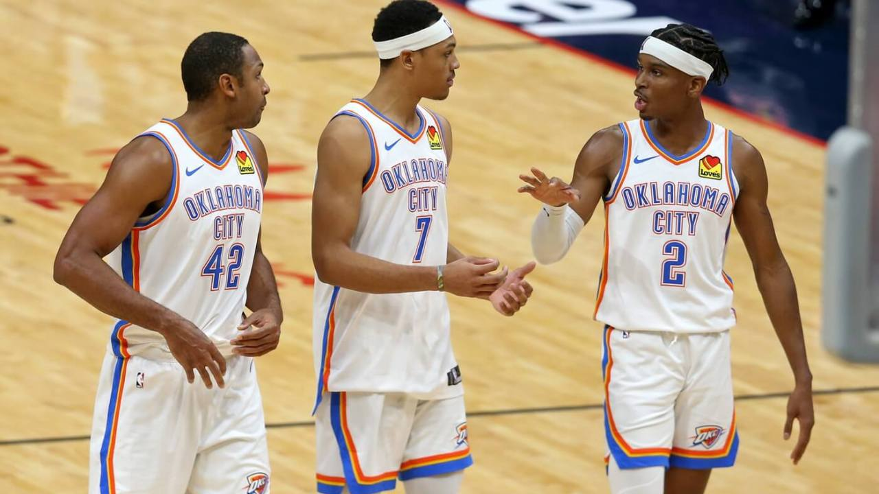Jan 6, 2021; New Orleans, Louisiana, USA; Oklahoma City Thunder center Al Horford (42) and forward Darius Bazley (7) and guard Shai Gilgeous-Alexander (2) talk in the fourth quarter against the New Orleans Pelicans at the Smoothie King Center. Mandatory Credit: Chuck Cook-USA TODAY Sports