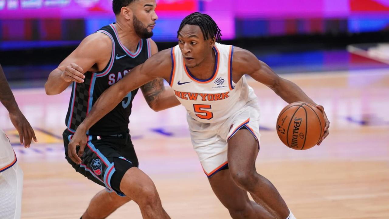 New York Knicks guard Immanuel Quickley (5) dribbles past Sacramento Kings guard Cory Joseph (9) in the first quarter at the Golden 1 Center.