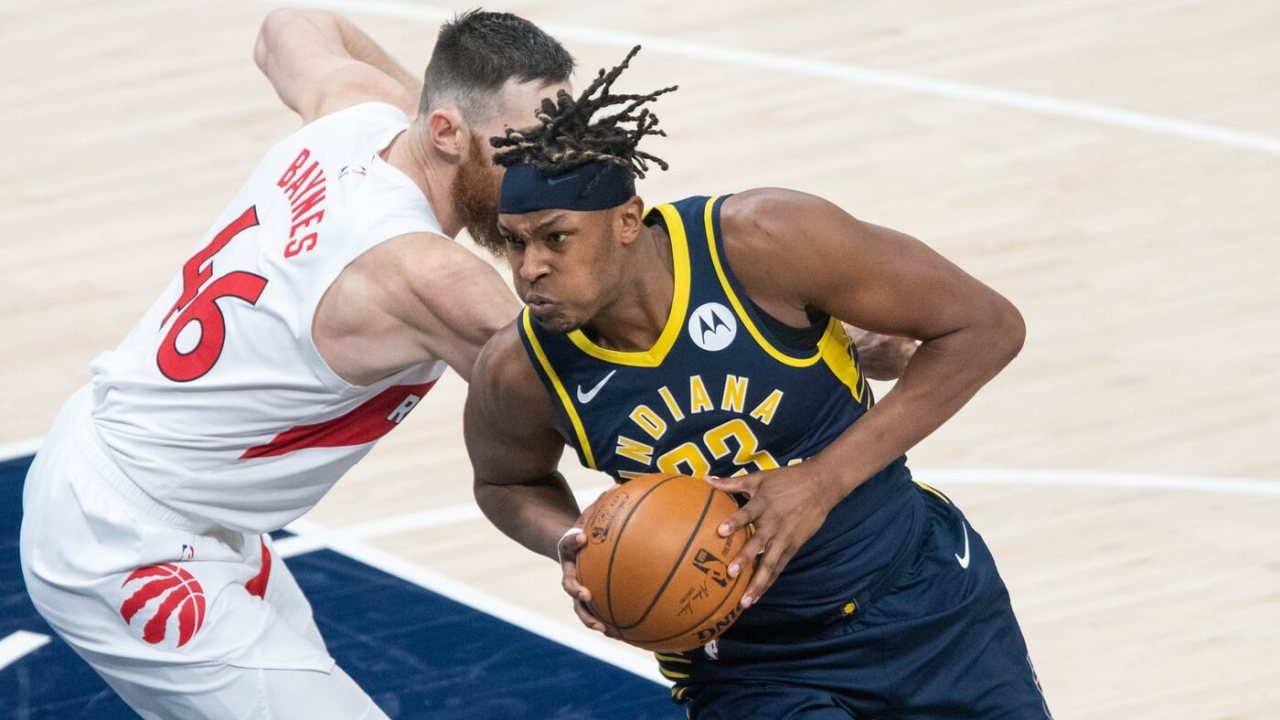 Indiana Pacers center Myles Turner (33) moves to shoot the ball while Toronto Raptors center Aron Baynes (46) defends in the second quarter at Bankers Life Fieldhouse.
