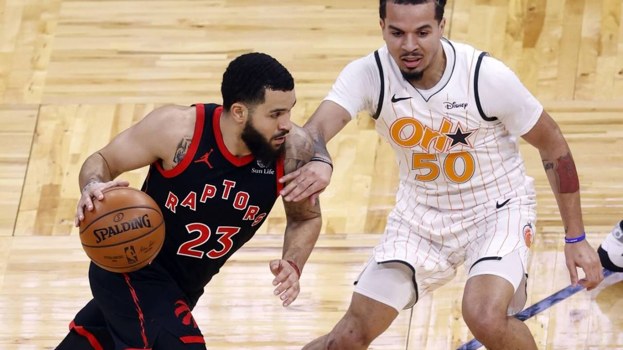 Toronto Raptors guard Fred VanVleet (23) drives to the basket as Orlando Magic guard Cole Anthony (50) defends during the first quarter at Amway Center.