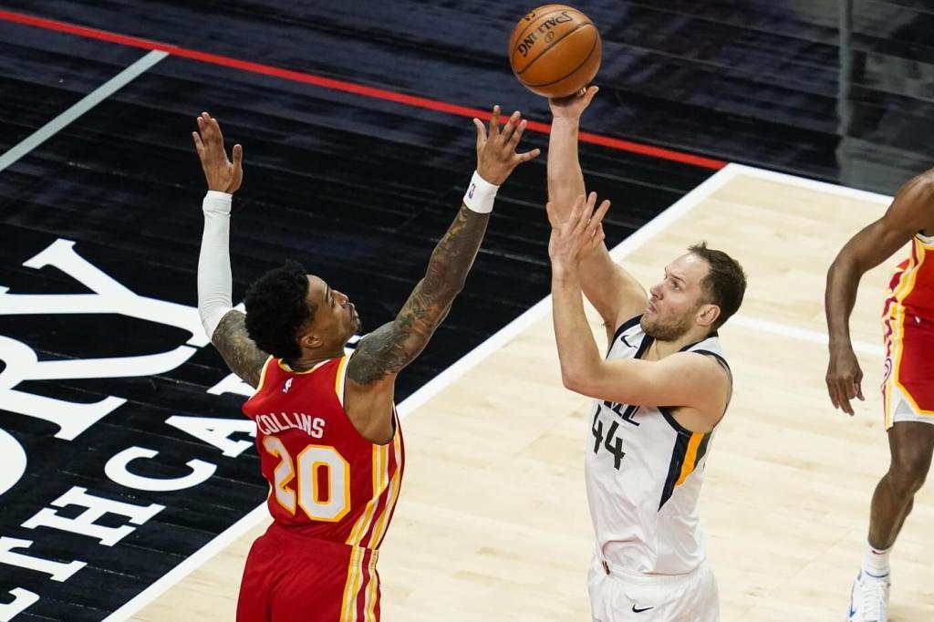 Utah Jazz forward Bojan Bogdanovic (44) shoots over Atlanta Hawks forward John Collins (20) during the first half at State Farm Arena.