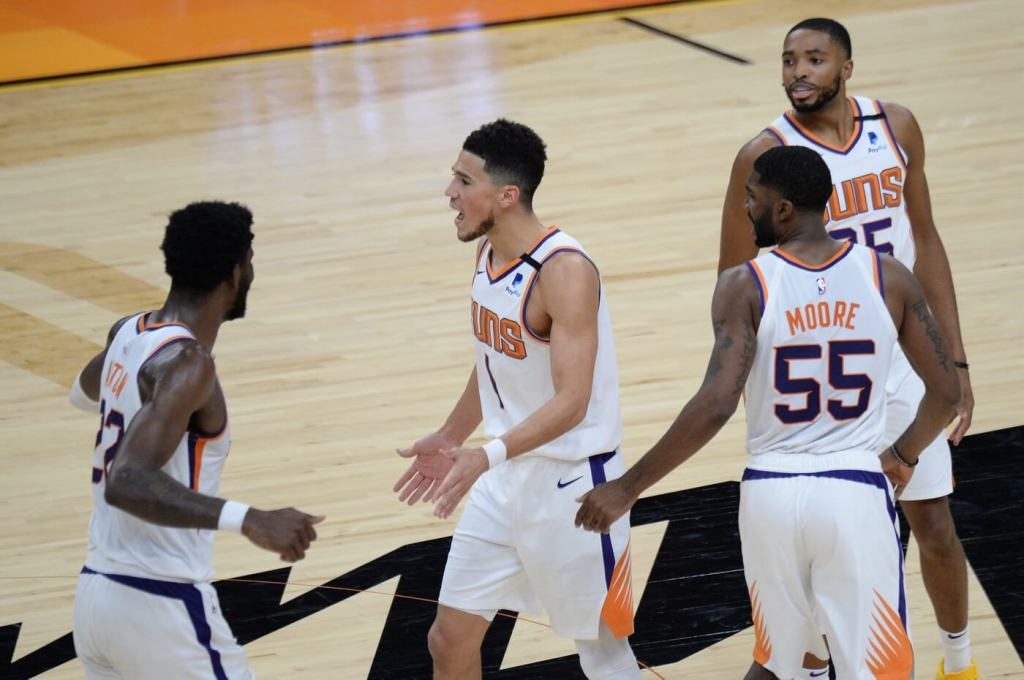 Phoenix Suns guard Devin Booker (1) celebrates with teammates during the second half against the Cleveland Cavaliers at Phoenix Suns Arena.